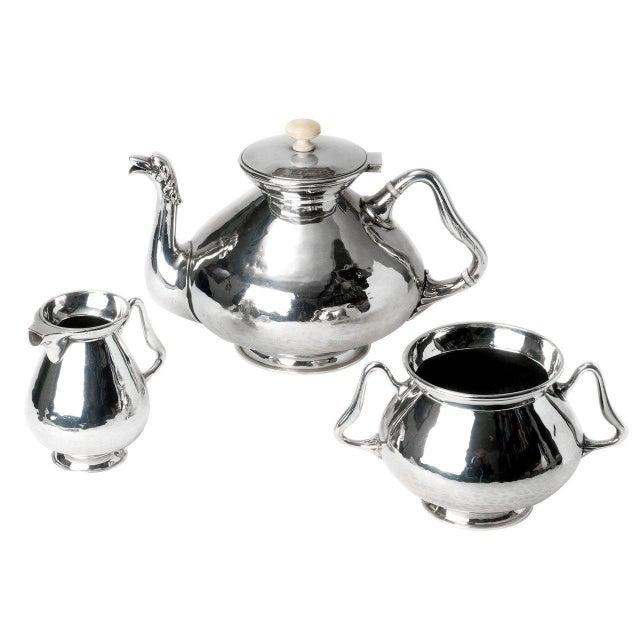 Antique elegant silver plate tea pot, sugar bowl and creamer. Dimensions (cms) Sugar Bowl: H11 D9.5 Milk Jug: H10 x W8...