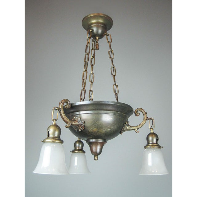 Arts & Crafts bowl fixture with original preserved finish. Cast arms are heavily detailed, central bowl is suspended from...