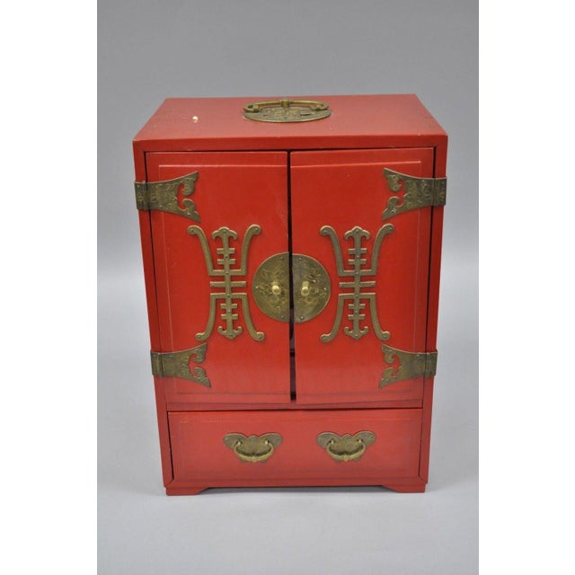 Vintage Red Lacquer Chinese Jewelry Box. Details: Dovetailed case construction, 6 padded drawers, ornate brass hardware,...