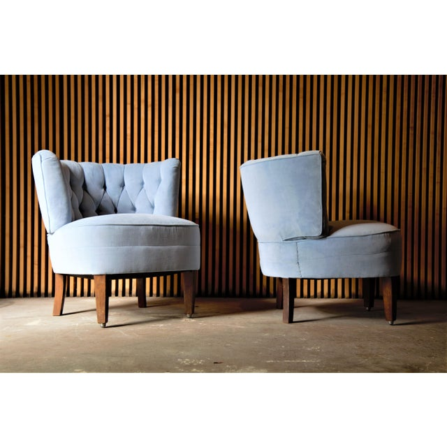 A pair of diamond tufted velvet lounge chairs attributed to Otto Schulz, 1940s Sweden. Condition: Original finish to the...
