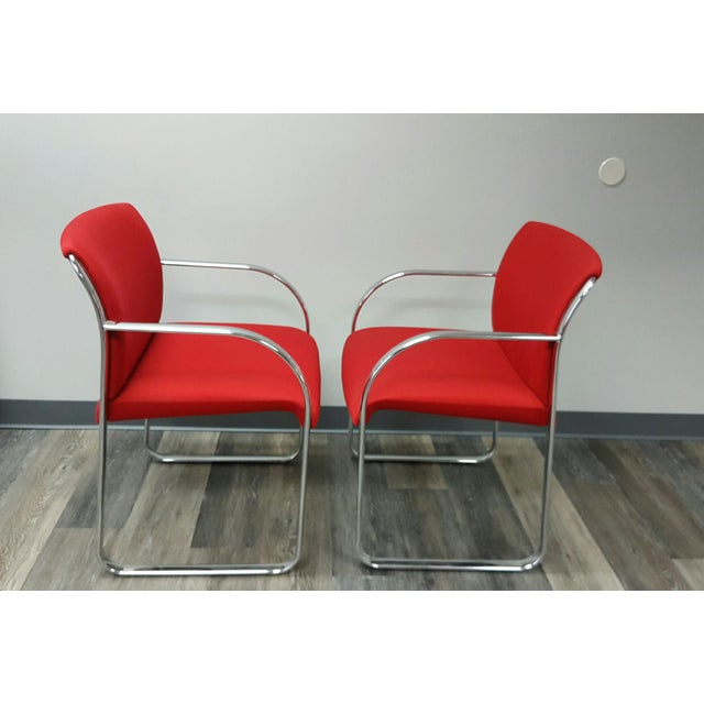 Lovely and comfortable Snodgrass chairs with cardinal red fabric, bright chrome and gorgeous curves. Rounded chrome base...