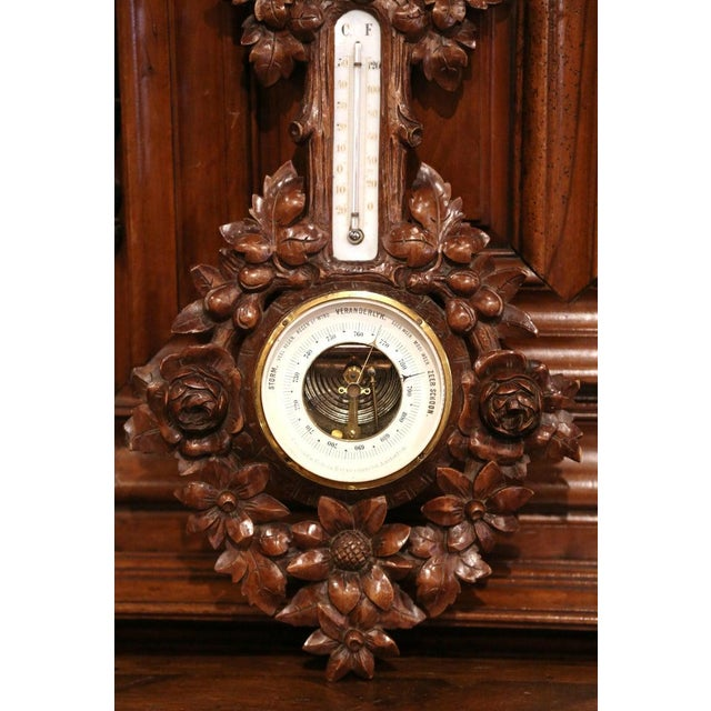 This elegant antique wall hanging barometer was crafted in France, circa 1880. The carved fruitwood weather and...