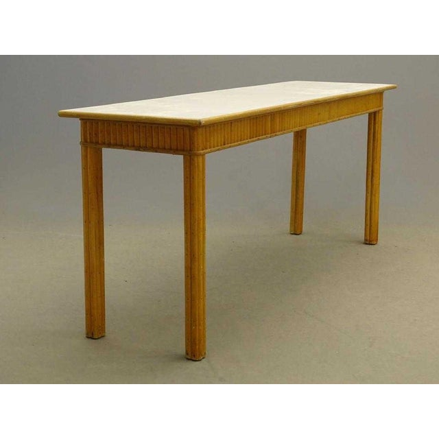 Long, sturdy rattan console table or server-could work in a kitchen as well as a hallway or living room. Has a formica...