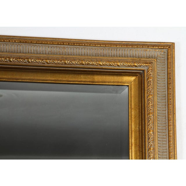 This is a vintage gilt gold and green wall mirror in great condition. Back slightly separated from the frame in the back,...