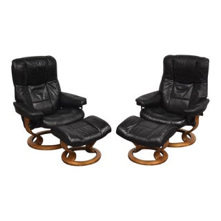 Black Leather and Teak Ekornes Lounge Chairs and Ottomans - a Pair For Sale