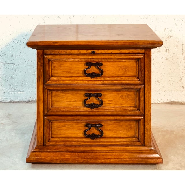 1970s three drawer end table in mahogany by Drexel Furniture Co. The table could also be a nightstand. The table does come...