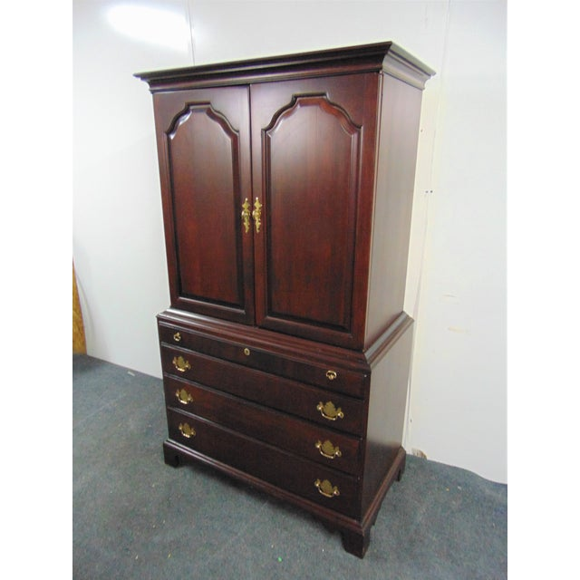 Durham Furniture Linen Press, Made in Canada , Chippendale style , Solid Cherry, 2 raised paneled doors with 3 adjustable...