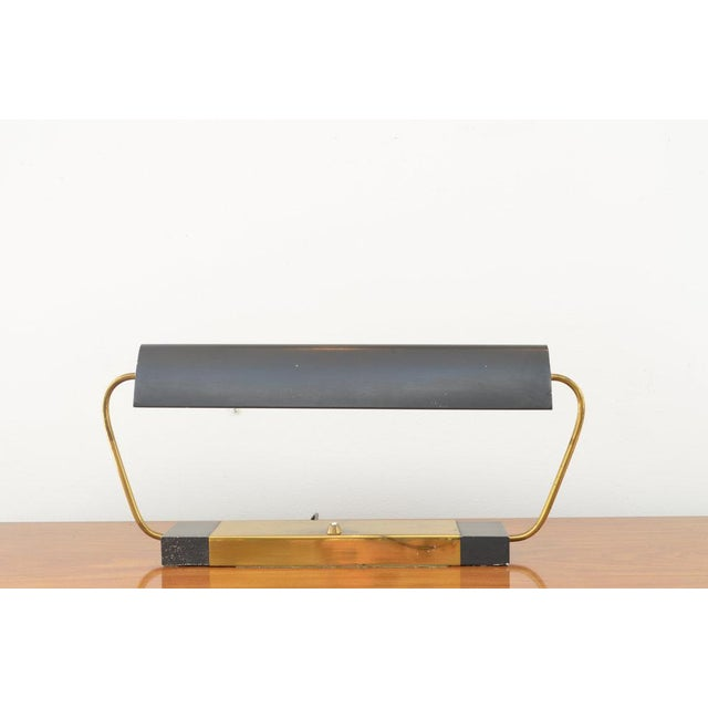 Polished Brass accents with Matte Black Finish Base and Shade. Patinated finish as typical with age / wear.