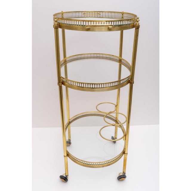 This stylish and chic petit bar cart is very much inspired by pieces created by Maison Jansen and it was purchased in...