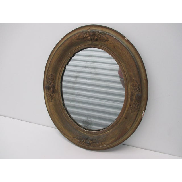 """Antique Oval Mirror with Distressed Gold Finish framed distress conditions from aged, shabby chic style. Size: 14"""" x 12"""" x 2"""