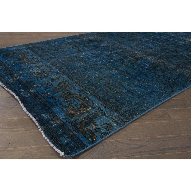 "A hand-knotted modern Overdyed rug with an allover design. This rug measures 4'0"" x 13'2""."