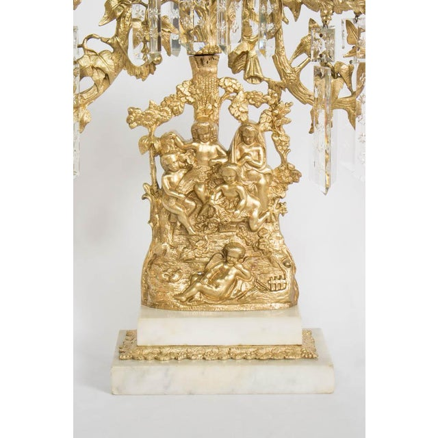 Gilt bronze three light ghirandole candelabra. Similar to the ones made by Cornelius & Company but by a lesser maker....