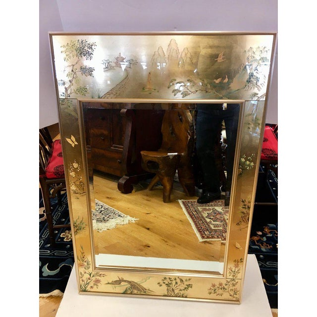 Stunning LaBarge eglomise beveled mirror with reverse painted Asian scenery on a gold background; hallmarks on back....