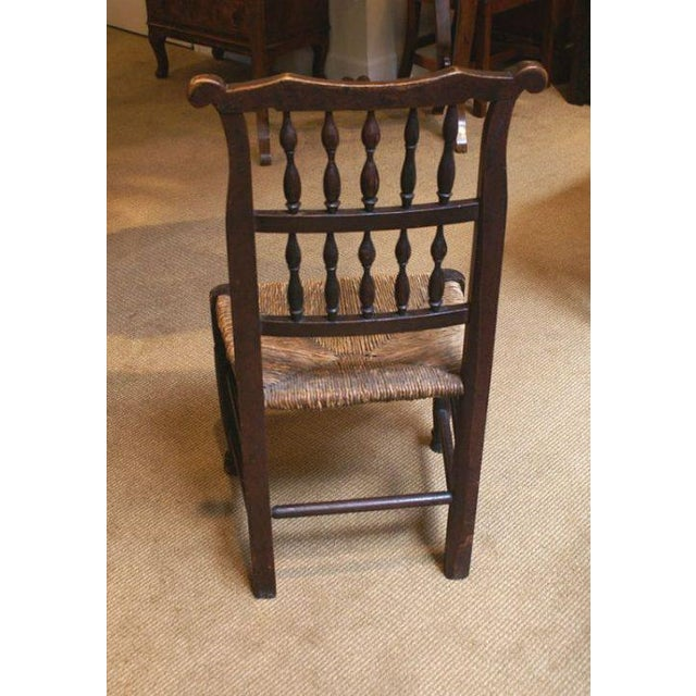 A decorative 18th Century English oak rush seated chair from about 1780. Great color and patina. The frame is solid....