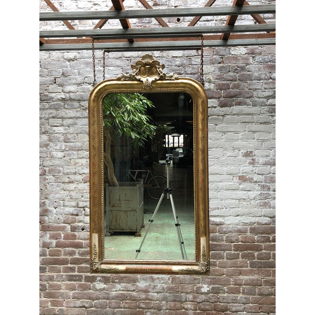 19th century mirror, gold leaf gilded in the style of Louis Philippe, provincial Provenance France. This 19th Century...