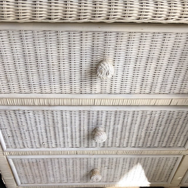 Beautiful white wicker dresser with gliding drawers which work beautifully. Vintage. Can be painted any color upon...