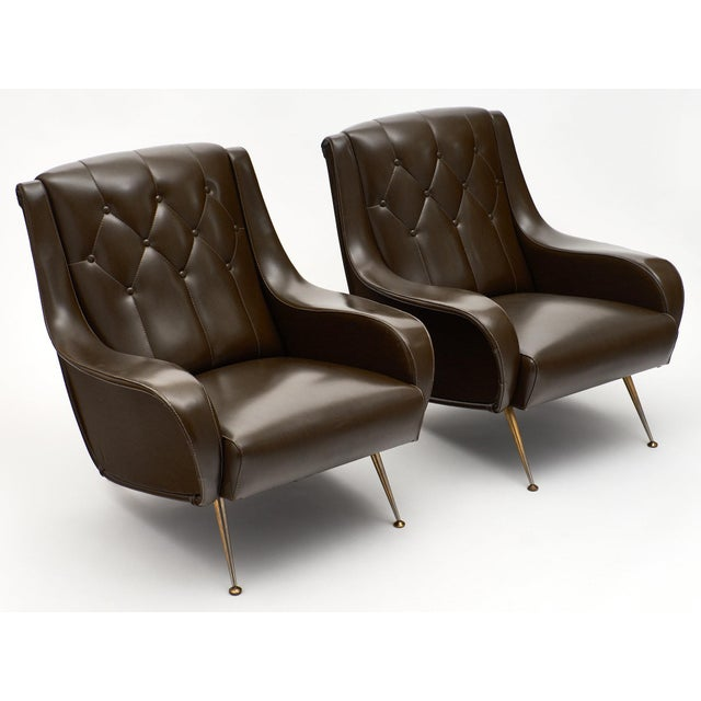 Modernist French vintage armchairs. A pair of comfortable armchairs with their original vinyl upholstery, tufted and in...