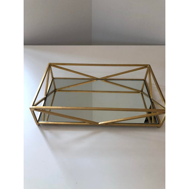 Rectangular tray in iron golf leaf with a mirror as the base.
