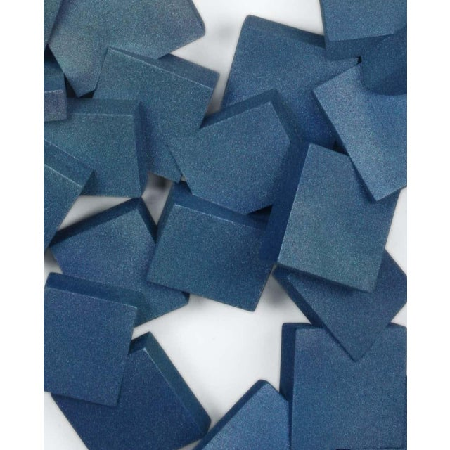 Sapphire Pyrites is an iridescent wall sculpture made out of solid wood and then painted and sealed. The geometric facets...