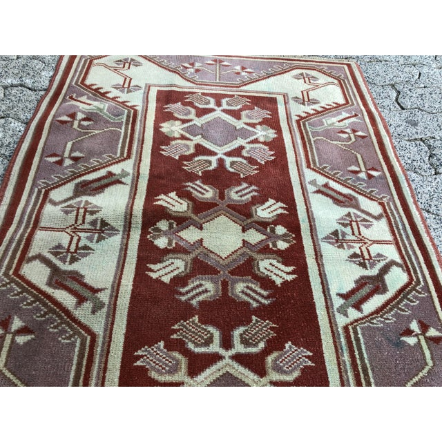 This is a vintage Turkish Oushak rug. The piece was handmade in the 1970s.