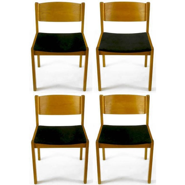 Set of four bleached mahogany frame and bent plywood back dining chairs with new textured black chenille upholstery. Made...