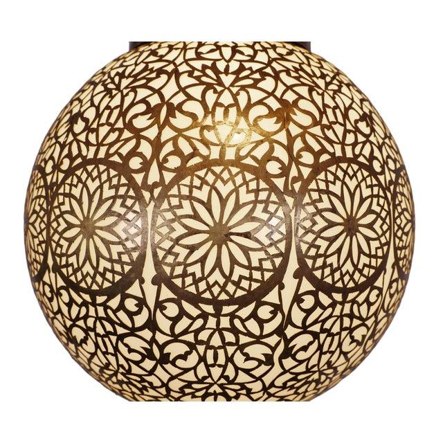 Vintage frosted glass globe lantern with hand cut brass work over lay in beautiful lacey patterns. Includes 3 ft of brass...