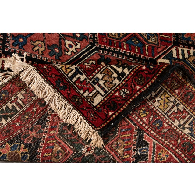 Beautiful Bakhtiari rug with a brownfield in all-over multi medallion design. This rug measures: 4'4'' X 7'2''