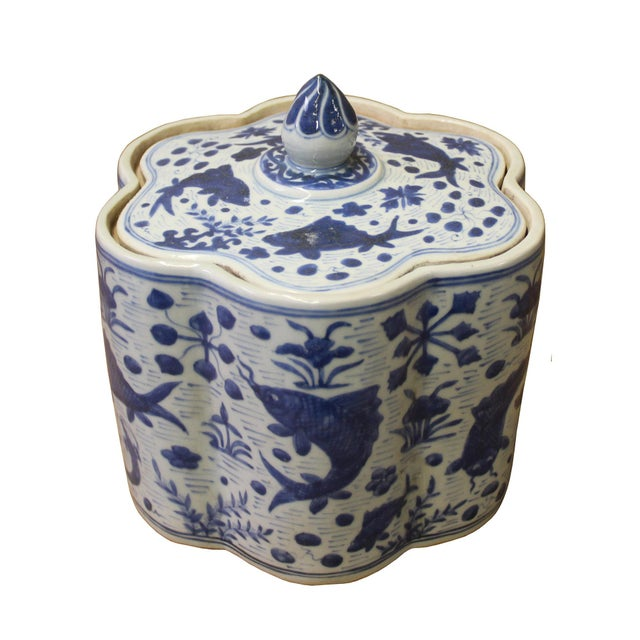 This is a traditional Chinese decorative porcelain jar in flower shape blue & white color with flowers & fishes pattern...