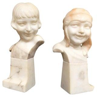 Hand-Carved Boy and Girl Alabaster Bust Set For Sale