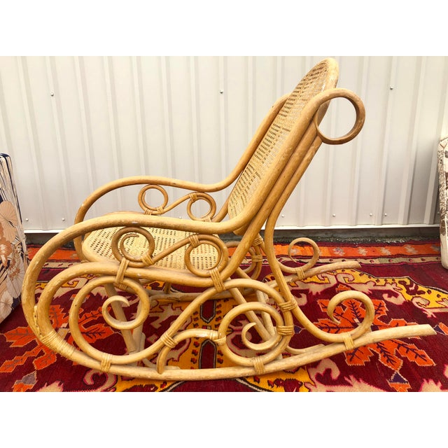 The best rocking chair on the planet! This boho babe is natural caned bamboo rattan. Comes sturdy and without breaks. Has...