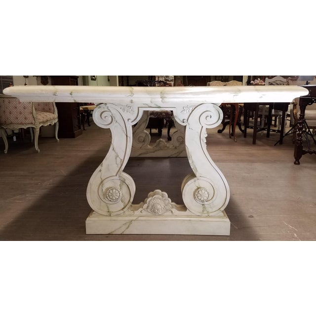 Vintage faux marble table, with Grecian carved legs. Good chair clearance for one's legs. 28 inch floor to table...