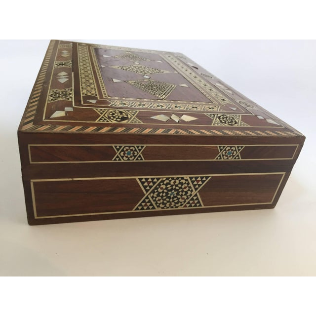 Antique Syrian wooden box inlaid with mother-of-pearl, marquetry with geometric Moorish designs in precious wood. Antique...