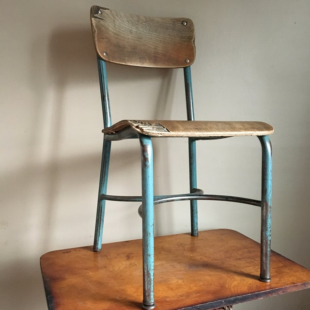 Super great chair with a solid blue metal base and a wooden seat. Originally in a NJ school, this chair has seen a lot of...