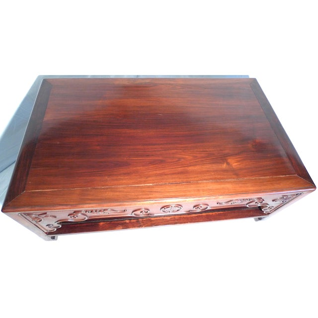 Offered is a striking heavy Chinese carved rosewood long low opium coffee table, two tiers. The rectangular table has a...