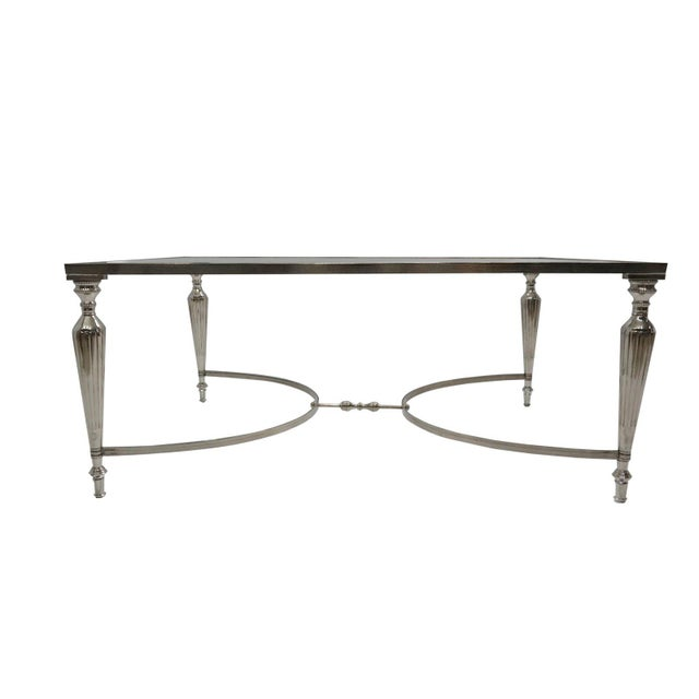 Delicate and reflective, this coffee table will add a glamorous touch to any room. This coffee table is stunning and the...