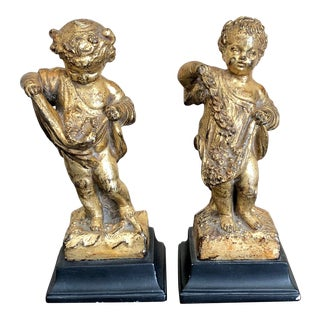 Florentine Carved Gilt Putti- a Pair For Sale
