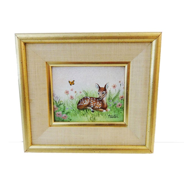 """Cute Hand painted painting on metal, depicting a seated deer Signed Trester .gold wood frame 7.75"""" h by 8.75"""" w 1.25' d..."""