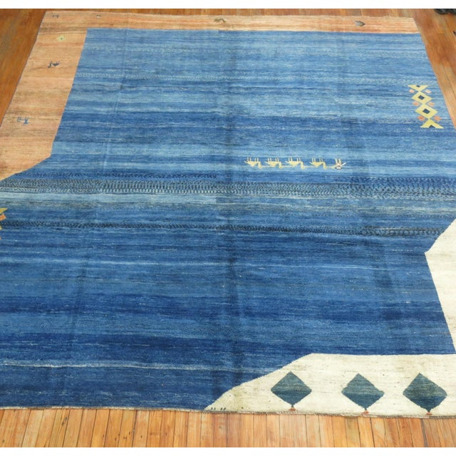 Room Size Persian Gabbeh Rug with an particularly abstract motif on a medium blue ground. hand-woven, 100 % vegetable dyed...