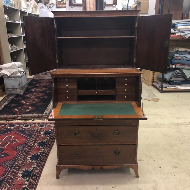 Antique English satinwood and mahogany butler's deal/secretary with bone pulls and dovetailed drawers. Made circa 1830.