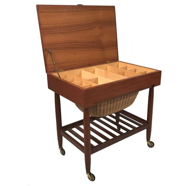 Really great sewing cart. Perfect for end table. Much storage under lift top and additional storage in basket drawer....