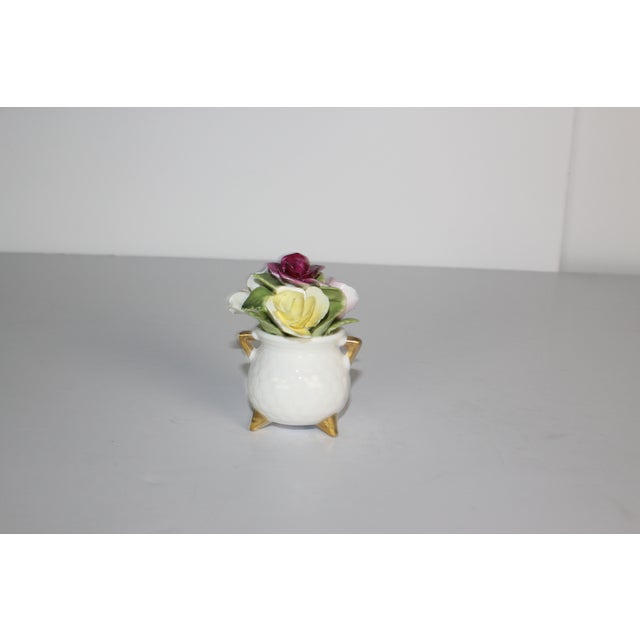 Fine quality hand colored porcelain flowers in a basket by Coal Port.
