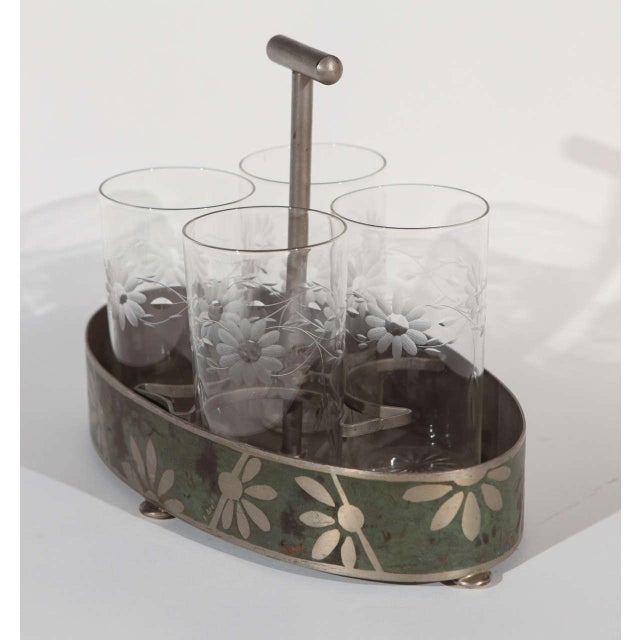 Dinanderie aluminum caddy, circa 1920-1930, with four glasses for your beverage of choice.