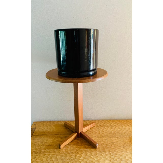 Here is a Modernist black planter set which includes a black glossy Gainey pot and matching drip plate. Marked on the...