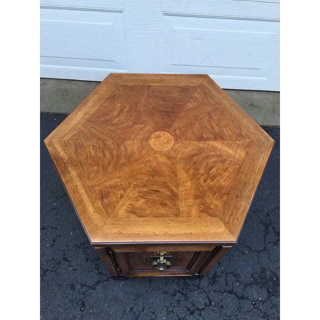 Asian inspired Thomasville hexagon side table. Asian inspired, antique brass door pull . Book matched burl wood. Circa...