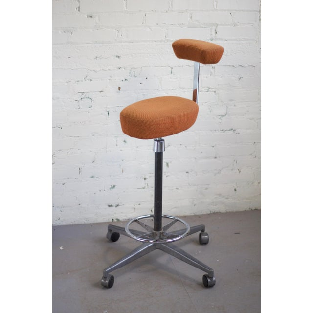 Stunning drafting stool by Herman Miller in original orange hopsack. The upholstery and foam are in wonderful condition...
