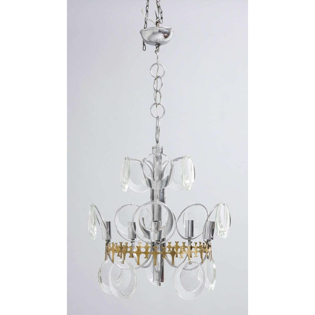 Beautiful 1960s Murano crystal pendant lamp by Vistosi with chrome and brass frame and faceted crystal disc glasses.