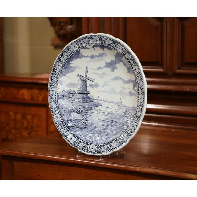 This large antique platter was crafted in Holland, circa 1920. The large, wall hanging plate depicts a lake scene with a...