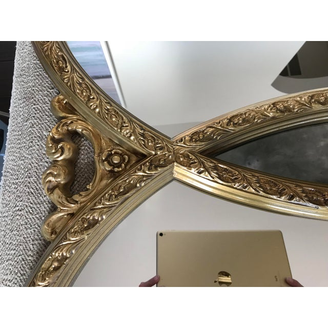 Hollywood Regency style double interlocking mirror with gold finish. The area where the pieces interlock is black...