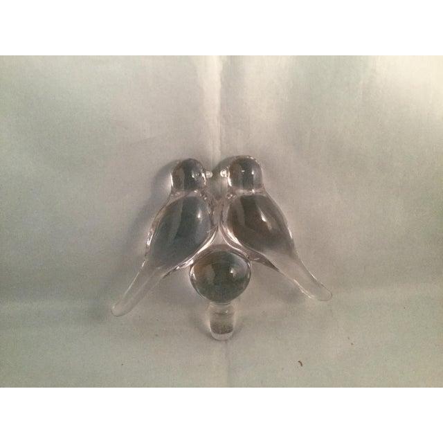 Glass bird perfume bottle stopper.