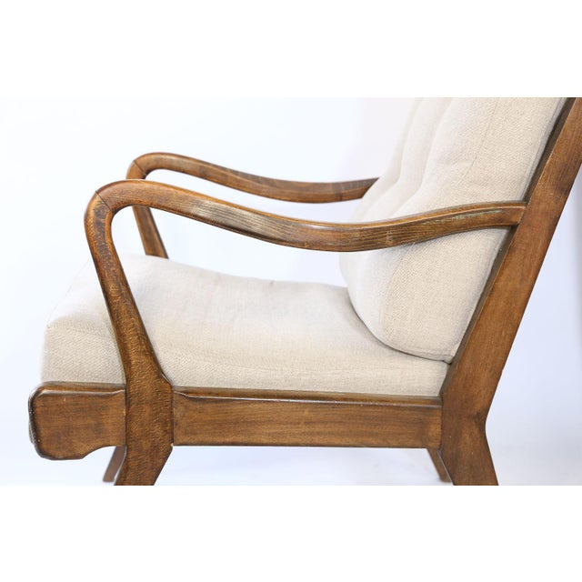 Found in France, this pair of Mid-Century Modern lounge chairs have been newly upholstered in a neutral linen. The chairs...